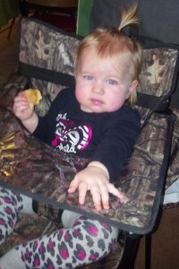 Shelby enjoying a cookie in ciao! baby chair